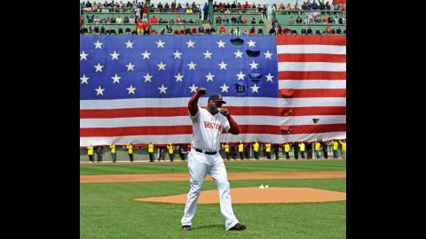 David Ortiz of the Boston Red Sox speaks to the crowd during a ceremony held in honor of the bombing victims before a baseball game against the Kansas City Royals at Fenway Park in Boston, on Saturday, April 20.