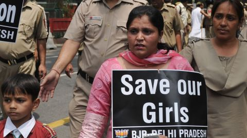 Political activists demonstration against the rape of a five-year old girl, in New Delhi on April 21, 2013