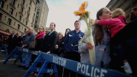 One week after the bombings, people gather to observe a moment of silence in Copley Square.