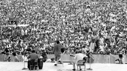 As the opening act at Woodstock, Havens takes the stage in front of thousands of people in Bethel, New York, on August 15, 1969.