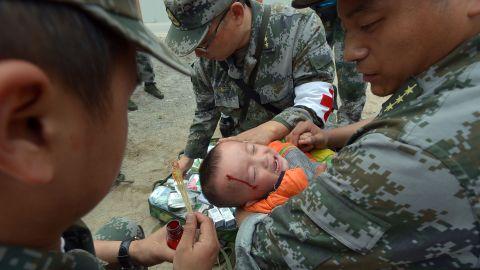 An injured boy receives treatment on Monday.