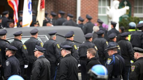 Law enforcement officials enter St. Patrick's Church prior to Collier's funeral in Stoneham, Massachusetts, on April 23, 2013.