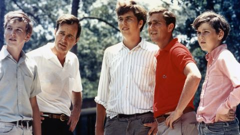 Bush, in the red shirt, is seen with his father and his three brothers in 1970. From left are Neil, George H.W., Jeb, George W. and Marvin.