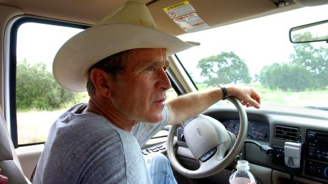 Bush drives his pickup truck at his ranch in Crawford, Texas, in 2002.