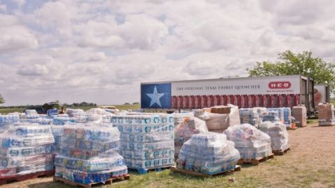 Water donations stack up at the site of Westfest, a fall celebration of Czech heritage.