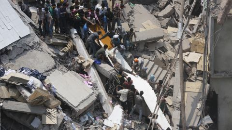 People search for garment workers trapped under the debris on April 24.