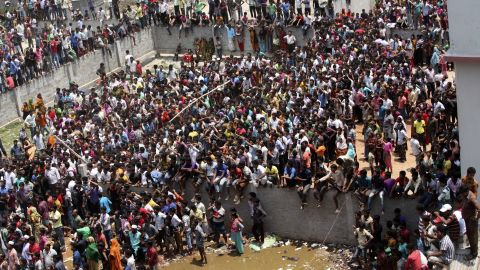 Hundreds watch the rescue operations on April 24.