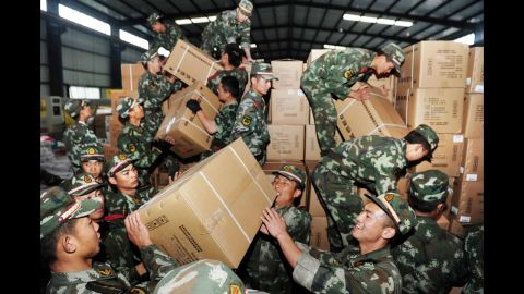 Rescue workers unload medicine in Ya'an on Tuesday.