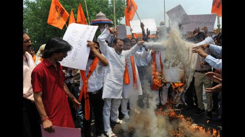 Activists burn an effigy of Delhi Chief Minister Sheila Dikshit during a protest in front the landmark of Red Fort in New Delhi on April 23.