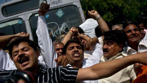 Activists protest in New Delhi on Monday, April 22.