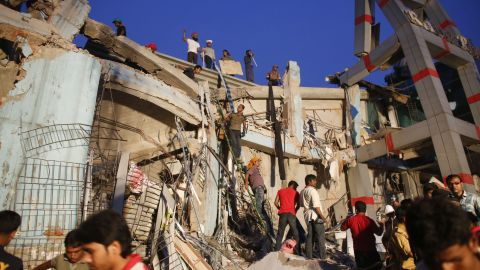 Rescue workers search for trapped garment workers in the Rana Plaza building on April 24.