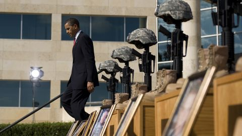 """Thirteen people were shot and killed by Maj. Nidal Hasan at Fort Hood in November 2009. Speaking to an estimated 15,000 people at a memorial service, Obama called the act """"incomprehensible"""" and vowed that justice would be done."""