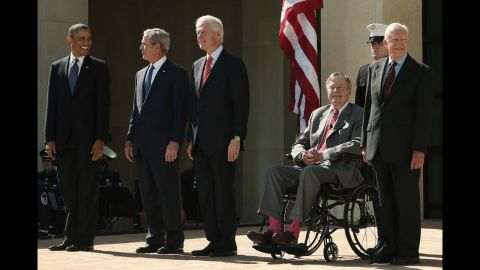 President Barack Obama and former presidents George W. Bush, Bill Clinton, George H.W. Bush and Jimmy Carter arrive on stage for the George W. Bush Presidential Center dedication ceremony.