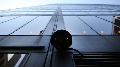 A surveillance camera attached to a building in the Financial District of New York City.