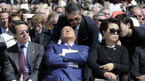 Former Italian Prime Minister Silvio Berlusconi, center, attends the ceremony.