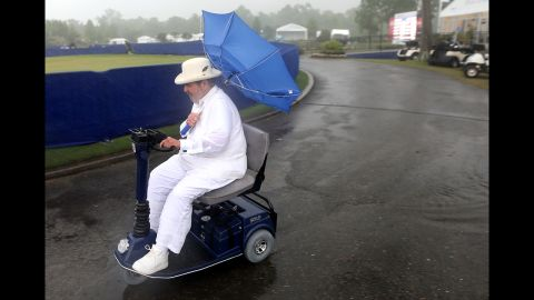 Chef Paul Prudhomme heads to the Zurich Classic Pro-Am clubhouse at TPC Louisiana as officials order the evacuation of all temporary structures after a tornado warning in New Orleans on Wednesday, April 24.