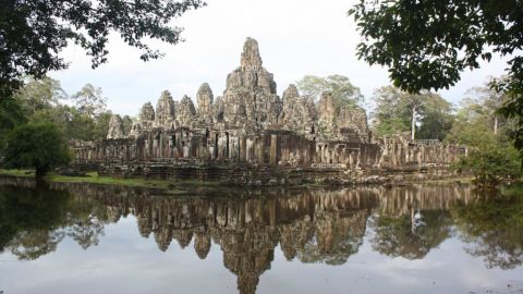 Scattered between the twisting roots of the Cambodian jungle, this site dedicated to the Hindu god Vishnu contains the remains of Khmer Empire capitals dating from the 9th to the 15th centuries. Among the most famous of its 100-strong group of monuments is the Temple of Angkor Wat and, at Angkor Thom, the sculptural Bayon Temple.