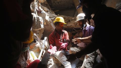Rescue workers search for survivors on April 28.