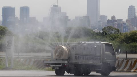 A New Taipei City Department of Environmental Protection truck sprays a virus disinfectant in a park on April 29.