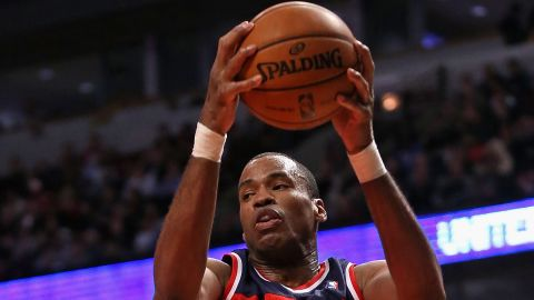 CHICAGO, IL - APRIL 17: Jason Collins #98 of the Washington Wizards rebounds against the Chicago Bulls at the United Center on April 17, 2013 in Chicago, Illinois. The Bulls defeated the Wizards 95-92. NOTE TO USER: User expressly acknowledges and agrees that, by downloading and or using this photograph, User is consenting to the terms and conditions of the Getty Images License Agreement.  (Photo by Jonathan Daniel/Getty Images) *** Local Caption *** Jason Collins