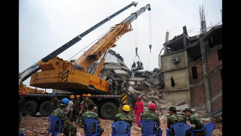 Bangladeshi army personnel begin the second phase of the rescue operation using heavy equipment on April 29.
