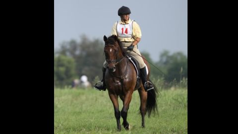 """Kathy Stim's first outing with ex-racehorse Archer (formerly Wood Be Me) was in 2010 at the Long Run Hounds Hunter Pace. She is the vice president of<a href=""""http://www.secondstride.org/index.html"""" target=""""_blank"""" target=""""_blank""""> Second Stride</a>, a thoroughbred rehabilitation farm, and adopted Archer there. Archer was almost put down because of his injuries."""