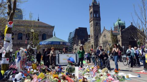 People pause at the memorial site in Boston's Copley Square on April 30, 2013.