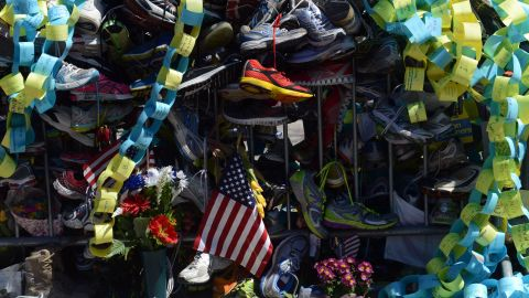 Running shoes were among the mementos left as a tribute to the bombing victims.