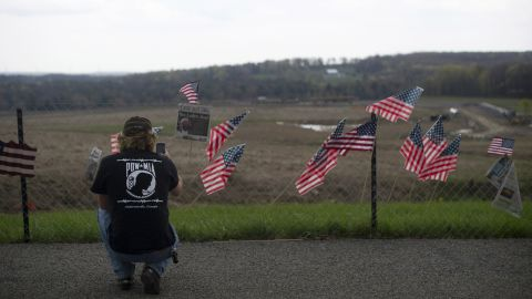 A visitor photographs the fence overlooking the crash site of Flight 93 in Shanksville, Pennsylvania, on May 2, 2011.