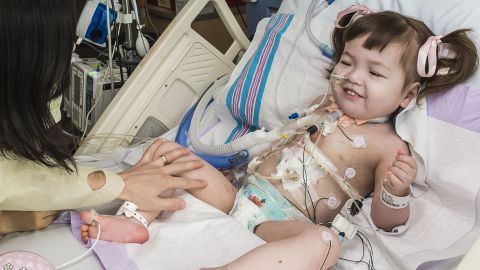 Hannah Warren, 2, recovers in a post-op room at the Children's Hospital of Illinois in Peoria.