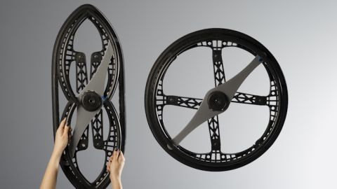 """Another update of an ancient yet unbeatable design -- the wheel. Devised by <a href=""""http://vitaminsdesign.com/projects/folding-wheelchair/"""" target=""""_blank"""" target=""""_blank"""">Vitamins design</a>, this is the first ever foldable wheelchair wheel, earning it this year's transport Design of the Year Award at London's Design Museum."""