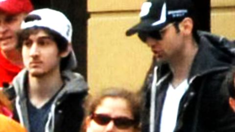 The Tsarnaev Brothers, behind barricades at the Boston Marathon, before the bombs went off.