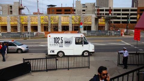 A CD102.5 truck parks outside a concert venue in Columbus.