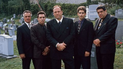 """Quite possibly the biggest anticlimax in TV history: Tony Soprano (James Gandolfini, center) meets his family in a restaurant and looks up, and then, with Journey's """"Don't Stop Believin' """" playing in the background, the screen cuts to black. """"Sopranos"""" fans have long debated the ending: Did Tony die or not? Creator David Chase has walked through the scene in detail but hasn't said one way or another."""