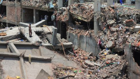 A man stands amid the destruction as rescue and army personnel continue recovery operations on May 3.