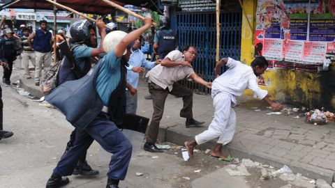 Bangladeshi police charge Islamists during clashes in Dhaka on Sunday.