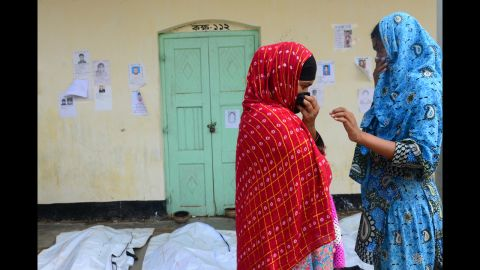 Relatives attempt to identify the bodies of loved ones on May 4.