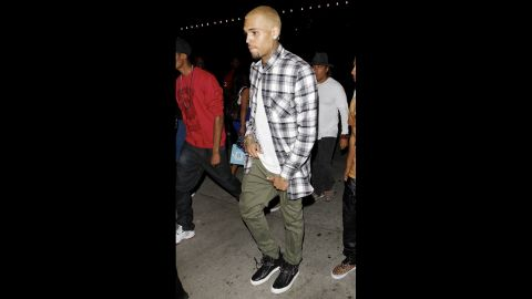 """Although Rihanna was infamous for <a href=""""http://marquee.blogs.cnn.com/2012/11/30/rihanna-posts-cuddly-pic-with-chris-brown/"""">sharing cozy photos</a> of herself with Brown on Instagram, he clarified in early May 2013 that they weren't a couple. """"[A]t the end of the day, shawty doing her own thang, she on the road. It's always gonna be love. I'm a grown man, just gotta fast forward,"""" he <a href=""""http://www.eonline.com/news/414993/chris-brown-confirms-rihanna-split-i-can-t-focus-on-wife-ing-someone-that-young"""" target=""""_blank"""" target=""""_blank"""">told an Australian radio station</a>. """"I'm always gonna love that person. I can't be focused on wife-ing someone that young. I need to be the best Chris Brown I can be."""""""