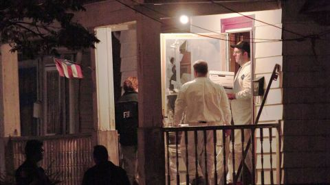 FBI agents remove evidence from the house May 7, 2013.