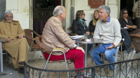 Anthony Bourdain, right, talks with British ex-pat Jonathan Dawson at Cafe Tingis in Tangier, Morocco.