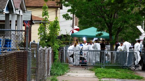 An FBI forensics team meets outside the house where three women were held as they investigate the property.