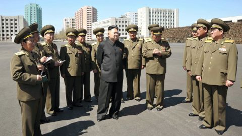 Kim visits the Ministry of People's Security in 2013 as part of the country's May Day celebrations.