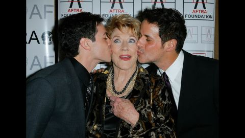 Actors David Lago, left, and Christian LeBlanc give Cooper playful kisses during the 2009 American Federation of Television and Radio Artists Media and Entertainment Excellence Awards on March 9, 2009, in Los Angeles.