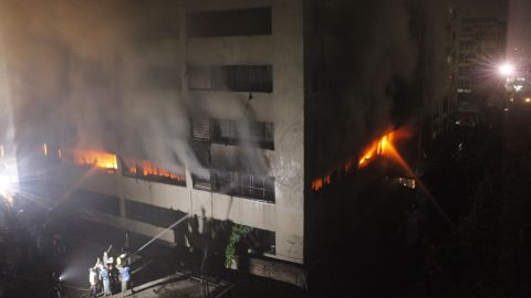 Bangladeshi firefighters attempt to extinguish a blaze at a garment factory in Dhaka early on Thursday, May 9. At least seven people were killed in the latest tragedy in Bangladesh's textile industry. Bodies are still being  pulled from the rubble of a  garment factory that collapsed on April 24, killing at least 900 people.