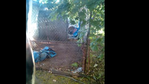 Neighbor Verdi Adams captured exclusive images from his backyard of the Cleveland home where three women were held captive for 10 years.