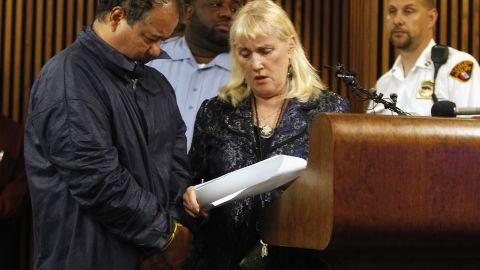 Castro hangs his head low while talking with his public defender, Kathleen DeMetz, during his arraignment on May 9.
