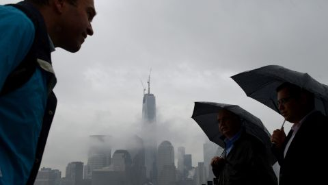 Rain doesn't deter an outing in Jersey City, New Jersey, and even a view of Lower Manhattan despite the fog on Thursday, May 9.