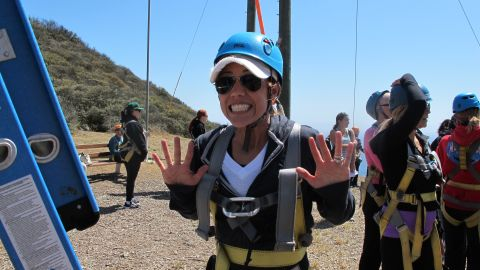 """A camper emerges triumphant from the """"leap of faith."""""""