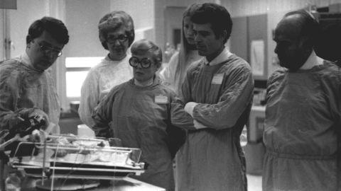 Brann, far left, talks to his colleagues at Grady Memorial Hospital in Atlanta in an undated photo.