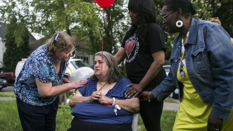 Deborah Knight, the grandmother of kidnapping victim Michelle Knight, participates in a community balloon-release service in Michelle's honor on Thursday, May 9, in Cleveland. Four females were found in a home on Seymour Avenue in the Clark Fulton neighborhood on Monday. Since then, the neighborhood and the nation have wondered how they were held captive without anyone noticing sooner.